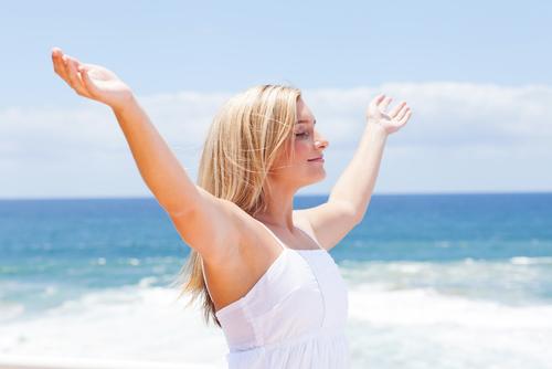 woman-beach-arms-130429